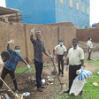 Sudanese volunteers clean the street during a cleaning campaign (Photo from Twitter, 23 June)