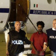 The suspect alleged to be people-smuggling kingpin Mered Medhanie arrives in Rome after being extradited from Sudan on June 7, 2016 (File photo: Italian Police Department)
