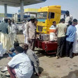 Entrepreneurial vendors in El Hajj Yousif in Khartoum provide refreshment to motorists forced to queue overnight for fuel (RD)