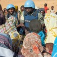 UN peacekeepers meet with displaced in a camp for displaced people in Darfur (file photo)