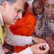 A child in Darfur gets an oral polio vaccin (UNICEF)