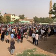 People gather in Burri, eastern Khartoum, on Thursday to protest the regime of President Omar Al Bashir (RD)