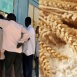 People queue in front of a Sudanese bakery because of the ongoing flour shortages (file photo)