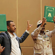 FCC leader Ahmed Rabee and Lt Gen Mohamed Hamdan 'Hemeti' hold copies of the Constitutional Declaration during the signing ceremony in Khartoum yesterday (Picture SUNA)