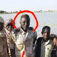 Ali Kushayb (C) in uniform with members of the Central Reserve Police (Abu Tira) in Darfur (File photo)