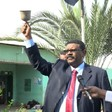 Governor of Khartoum, Ayman Nimir, rings a school bell to signal the start of the Sudanese certificate examinations (SUNA)