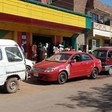 People waiting to buy bread behind a line of vehicles waiting to buy fuel, Khartoum, September 28 (Social media)